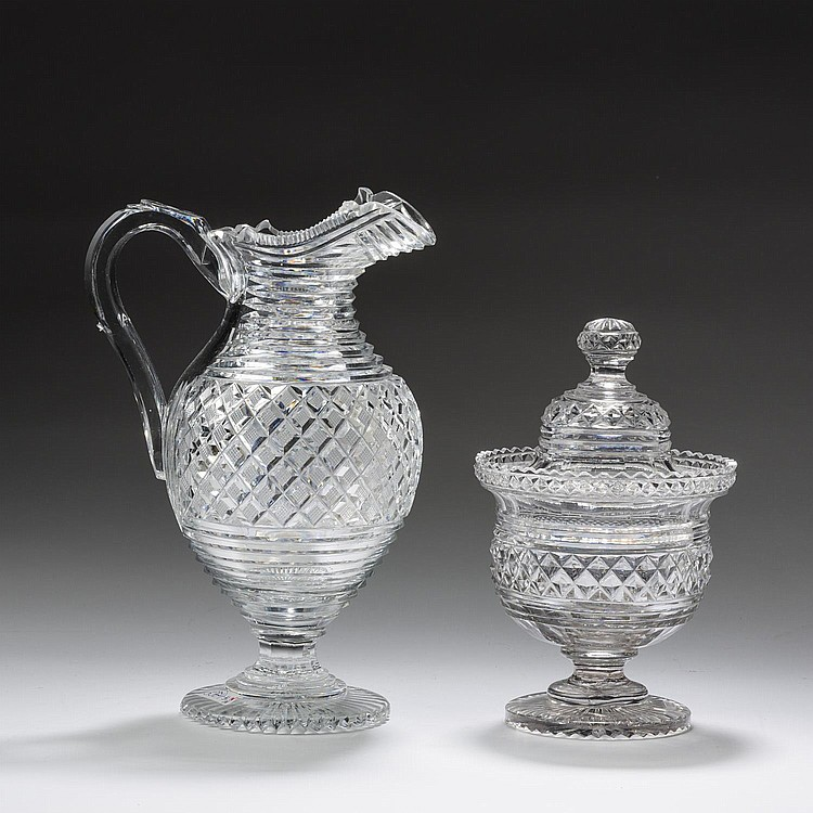 ANGLO-IRISH CUT-GLASS SWEETMEAT JAR AND COVER AND A PITCHER, NINETEENTH CENTURY.