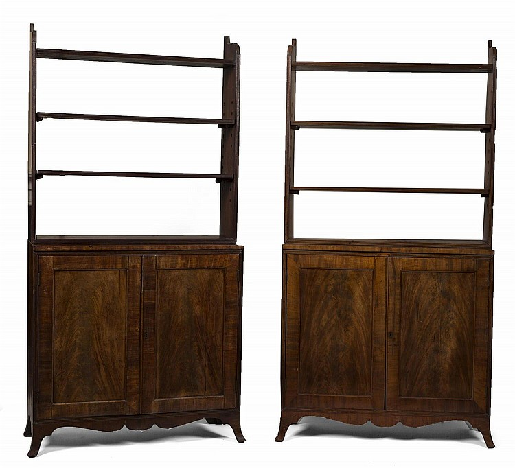 TWO MATCHING ENGLISH REGENCY MAHOGANY BOOKCASE CABINETS.
