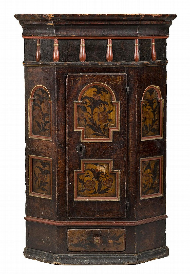 SCANDINAVIAN RED PAINTED AND DECORATED CORNER CUPBOARD WITH SINGLE DOOR AND SHAPED RECESSED PANELS AND SHOE FEET, DATED 1789.