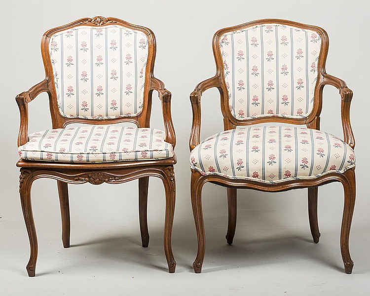 TWO SIMILAR LOUIS XV STYLE FRUITWOOD OPEN ARMCHAIRS.