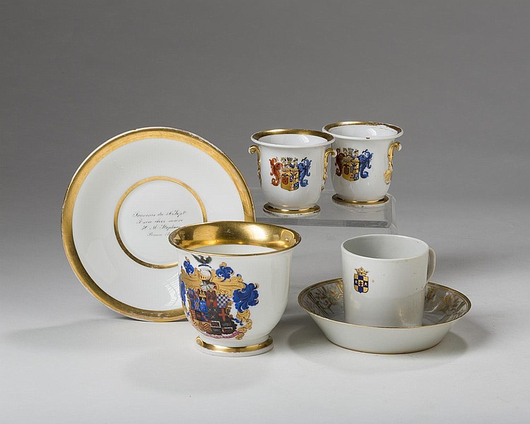 KPM (BERLIN) PORCELAIN ARMORIAL COMMEMORATIVE CABINET CUP AND SAUCER WITH THE ARMS OF STEPHENS, DATED 1861.