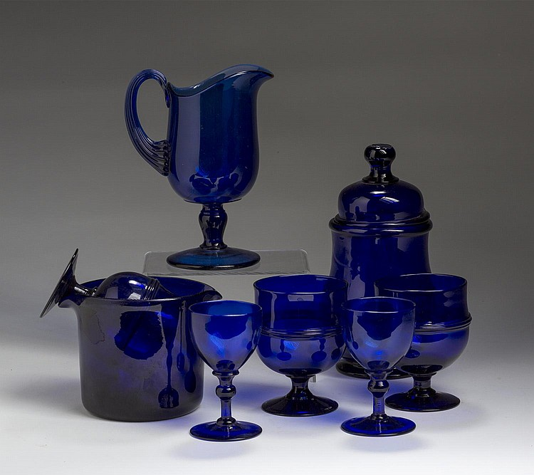 GROUP OF AMERICAN AND CONTINENTAL PRESSED AND PATTERN-MOLDED COBALT BLUE GLASS WARES, SECOND HALF NINETEENTH AND TWENTIETH CENTURIES.