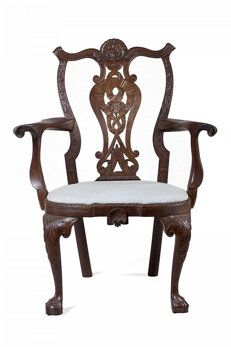 AMERICAN ROCOCO ELABORATELY CARVED MAHOGANY OPEN ARMCHAIR.