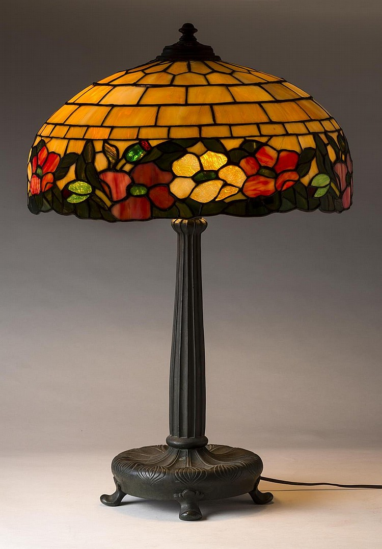 AMERICAN LEADED GLASS AND CAST PATINATED-BRONZE TABLE LAMP, EARLY TWENTIETH CENTURY.