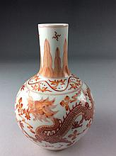 Chinese uncerglazed red porcelain baluster form vase, marked