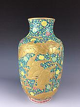 Rare Qianlong style porcelain, enameled floral vase with relief gilt cranes, marked