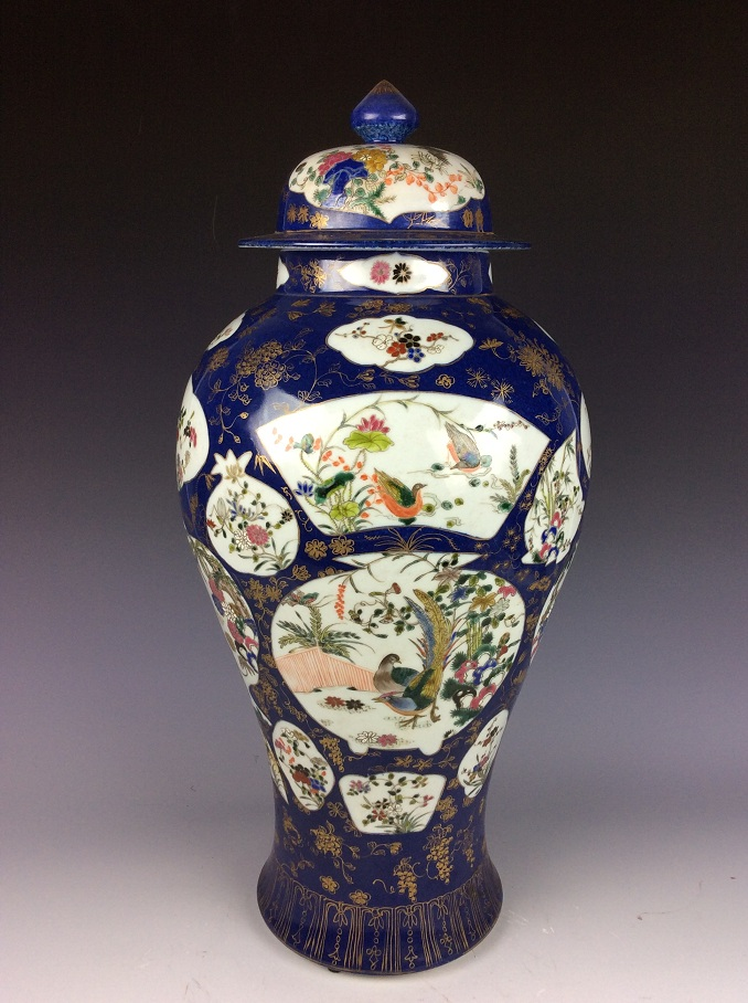 Fine Chinese porcelain vase, blue ground with panels, famille rose decorated with marked