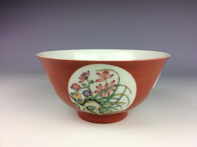 Fine Chienese porcelain bowl, red ground with panels, decoraed with famille rose flowers, marked