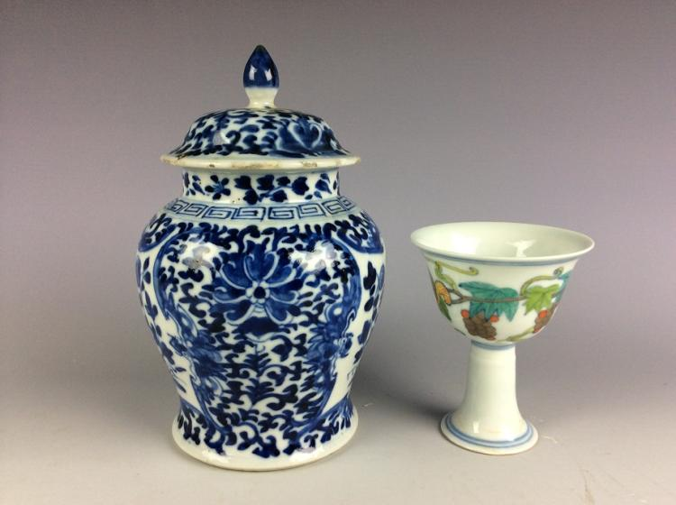 A set of Chinese porcelain, one blue & white vase and one Sancai cup, decorated and marked.