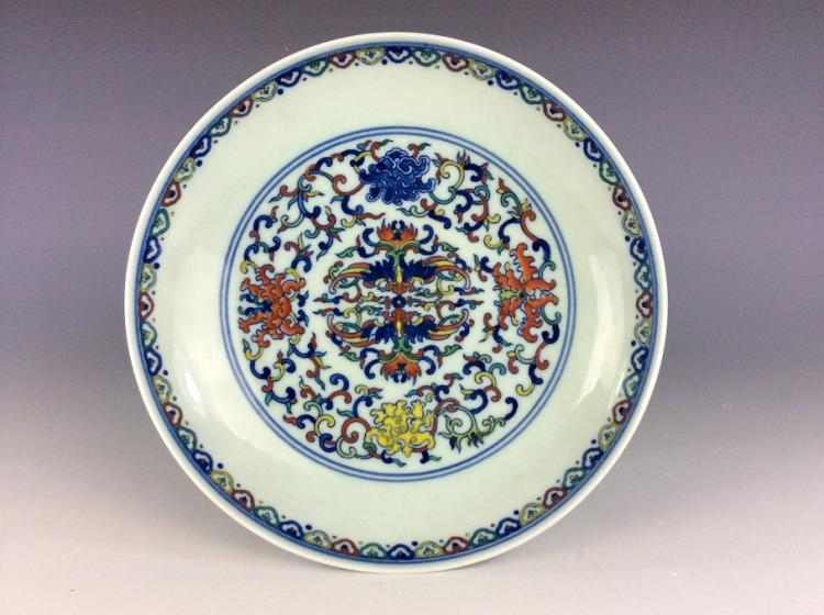 Fine Chinese porcelain plate, famille rose glazed, decorated and marked.