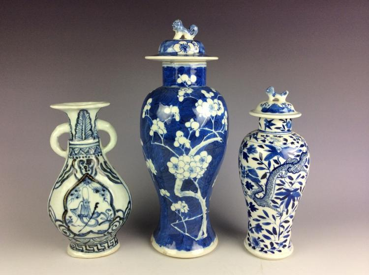 A set of three Chinese porcelain vases,  blue and white glazed, decorated.