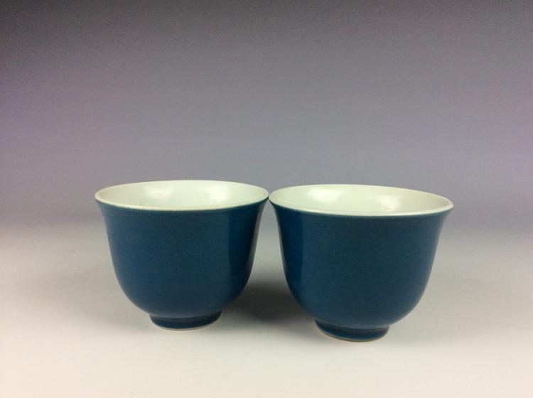 A pair of Chinese porcelain cups,  blue glazed, marked