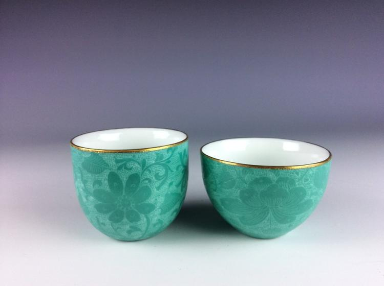 A set of Chinese porcelain boel, green glazed, marked