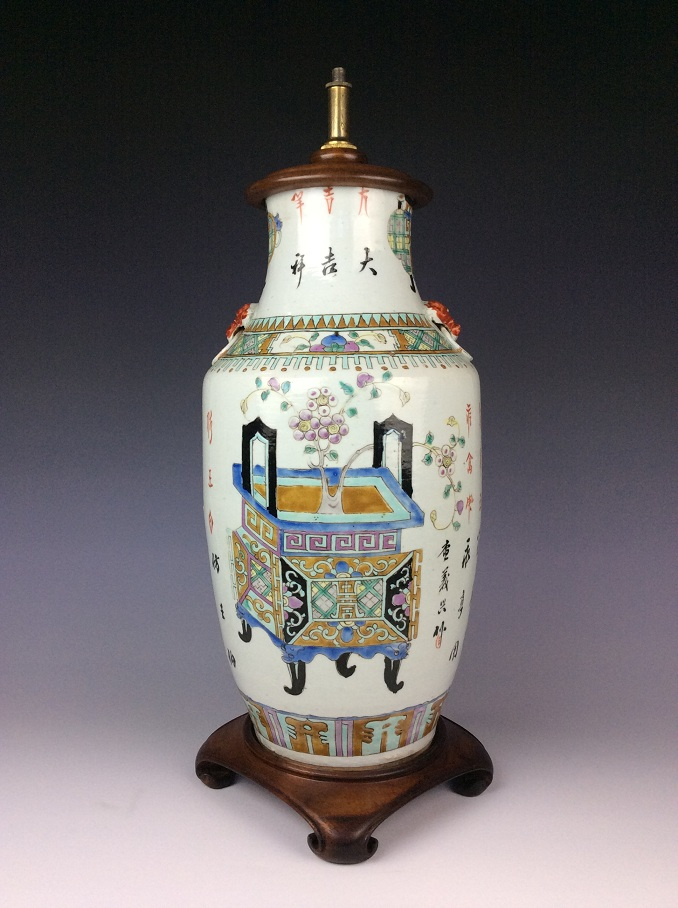 Chinese famille rose porcelain vase with still life design and calligraphy inscription,used as a lamp base.