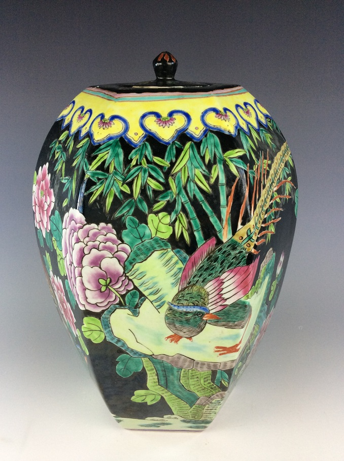 (A) Chinese black ground porcelain hexagonal lidded pot, painted with bird and peony.