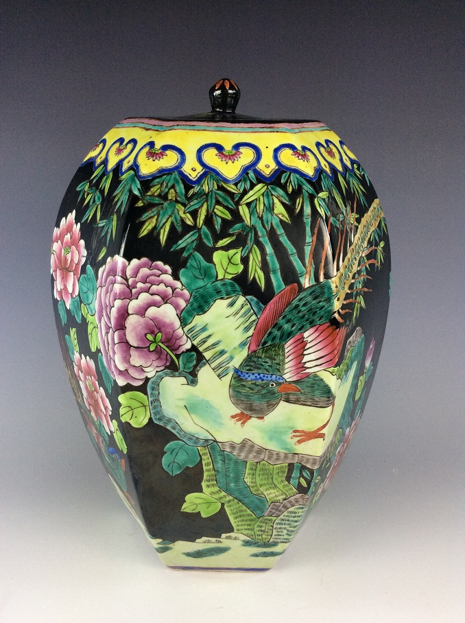 (B) Chinese black ground porcelain hexagonal lidded pot, painted with bird and peony.