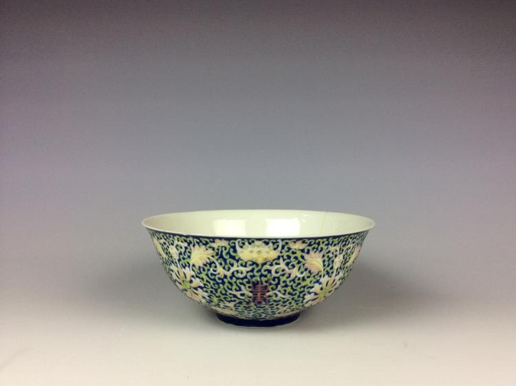 Chinese cobalt blue glaze porcelain bowl painted with floral interlocking branch, six character mark on base.
