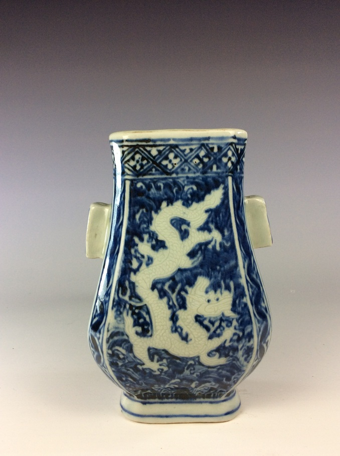 Chinese blue and white porcelain vese with double ears painted with dragon, marked on base.