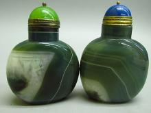 Set of Chinese porcelain and Peking glass snuff bottles.