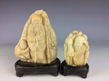 Two of  Chinese stone curved figures