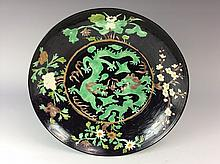 Chinese verte porcelain plate.  black ground, green glazed dragons,  marked