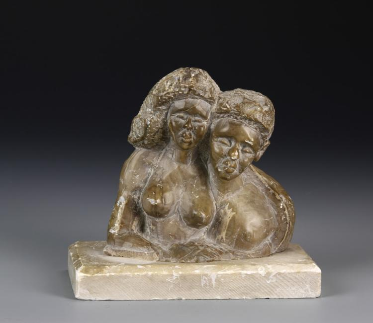 African Stone Sculpture Of A Man And A Woman
