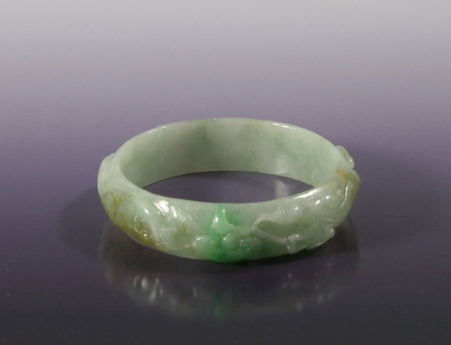A Carved Jadeite Bangle