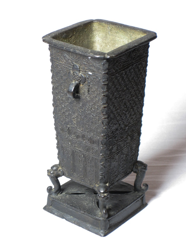 A bronze rectangle brush pot