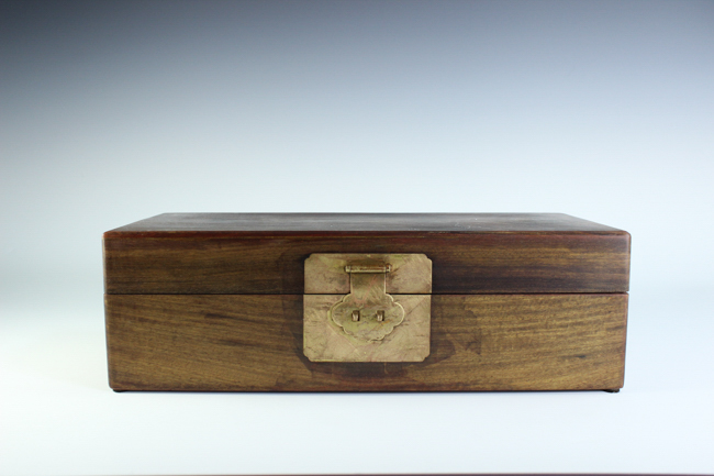 A jewelry hard wood box mounted with metal clip
