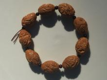 A Carved God of Lucky Three Pit Nut Bracelet