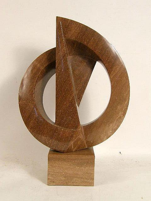 A CONTEMPORARY CARVED AND POLISHED GRANITE SCULPTURE