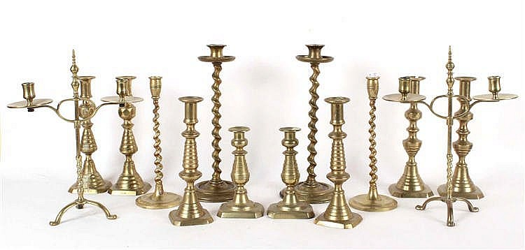 Fourteen Cast-Brass Candlesticks
