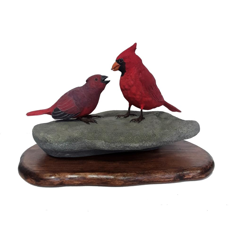 Tony Bendig's Male Cardinal Feeding Young Carving