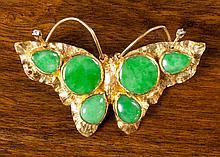 GREEN JADE AND TWENTY-TWO KARAT GOLD BROOCH.  The