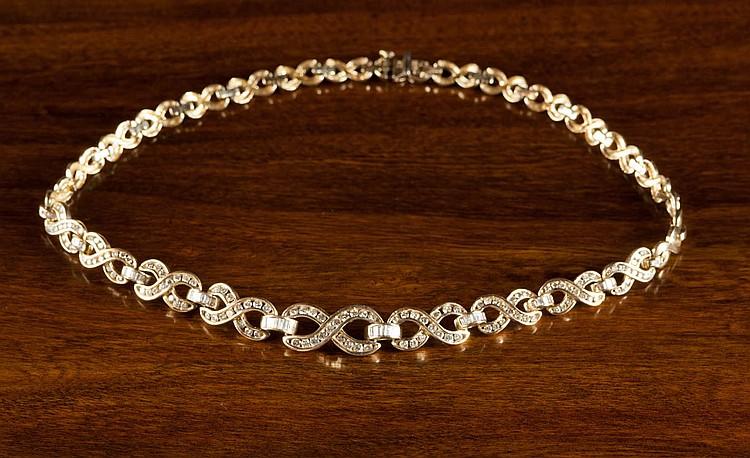 DIAMOND AND FOURTEEN KARAT GOLD NECKLACE, measurin