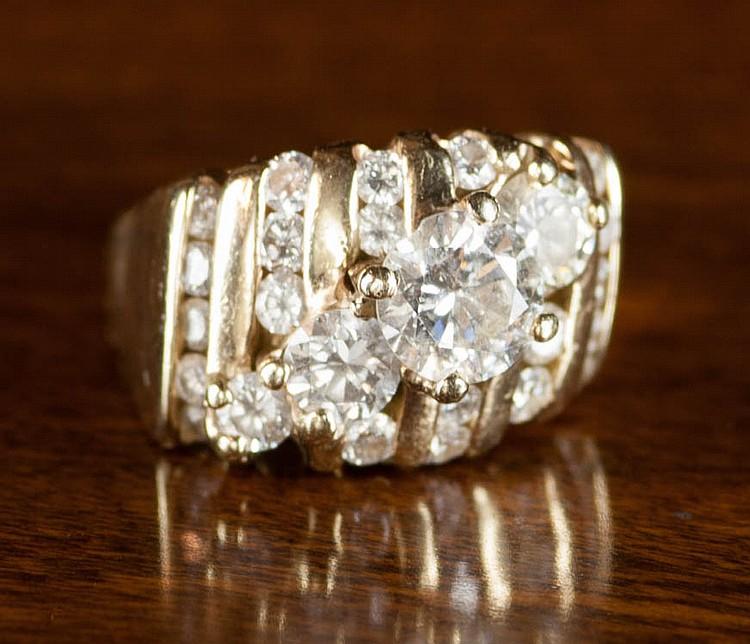 DIAMOND AND FOURTEEN KARAT GOLD RING, with six row