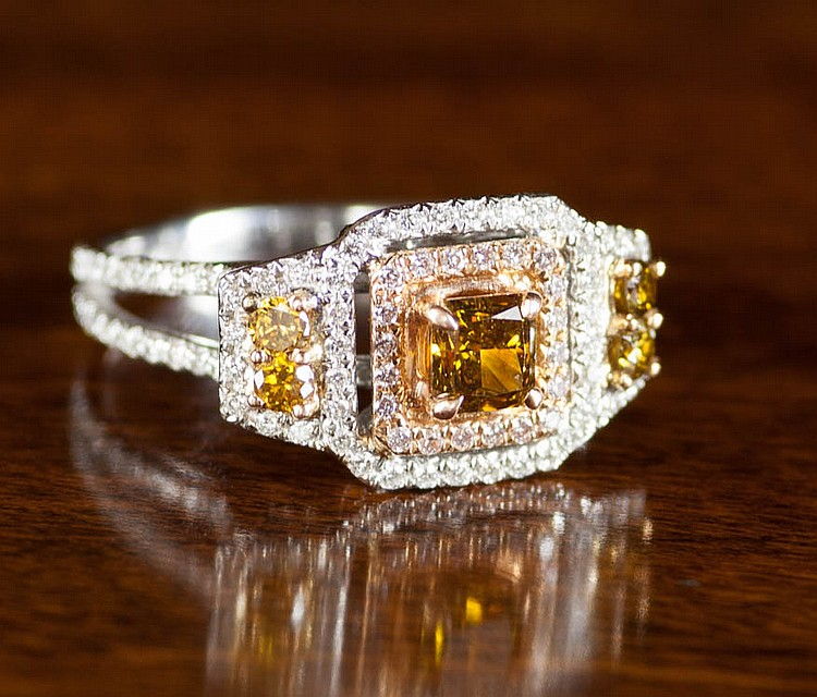 FANCY COLORED DIAMOND AND EIGHTEEN KARAT GOLD RING