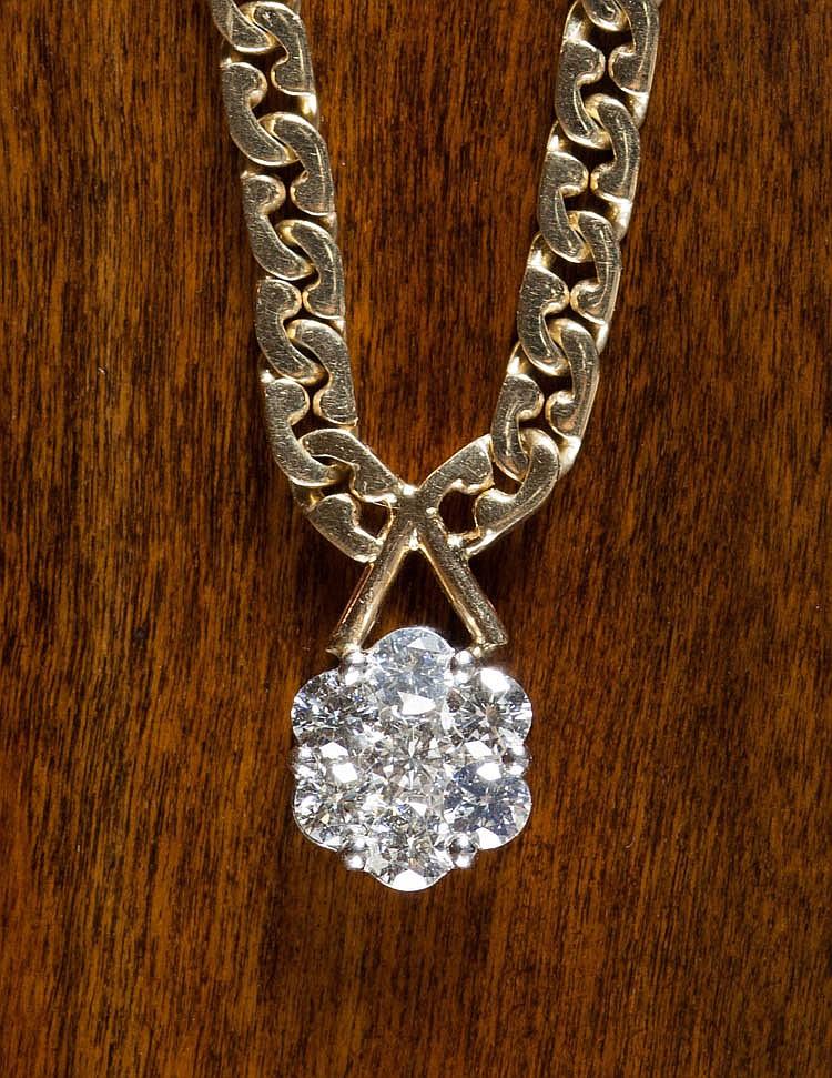 DIAMOND AND FOURTEEN KARAT GOLD NECKLACE.  Secured
