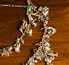 TRIPLE STRAND GOLD CHARM NECKLACE, featuring appro