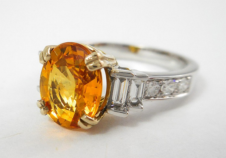 ORANGE SAPPHIRE AND DIAMOND RING, 14k white and ye