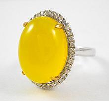 GOLDEN PREHNITE AND DIAMOND RING, 14k white and ye