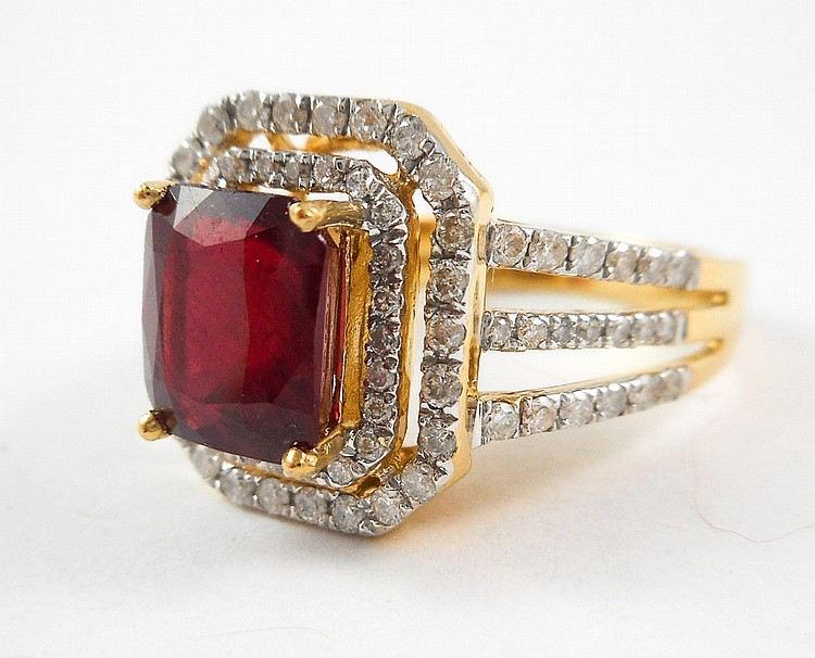 RUBY, DIAMOND AND FOURTEEN KARAT GOLD RING, with 8
