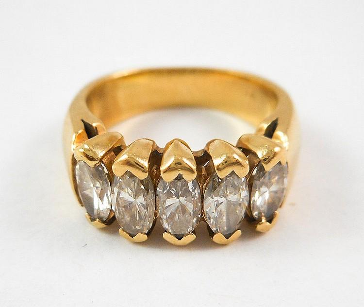 DIAMOND AND FOURTEEN KARAT GOLD RING, set with fiv
