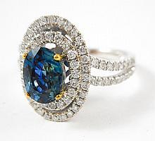 SAPPHIRE, DIAMOND AND FOURTEEN KARAT GOLD RING.  T