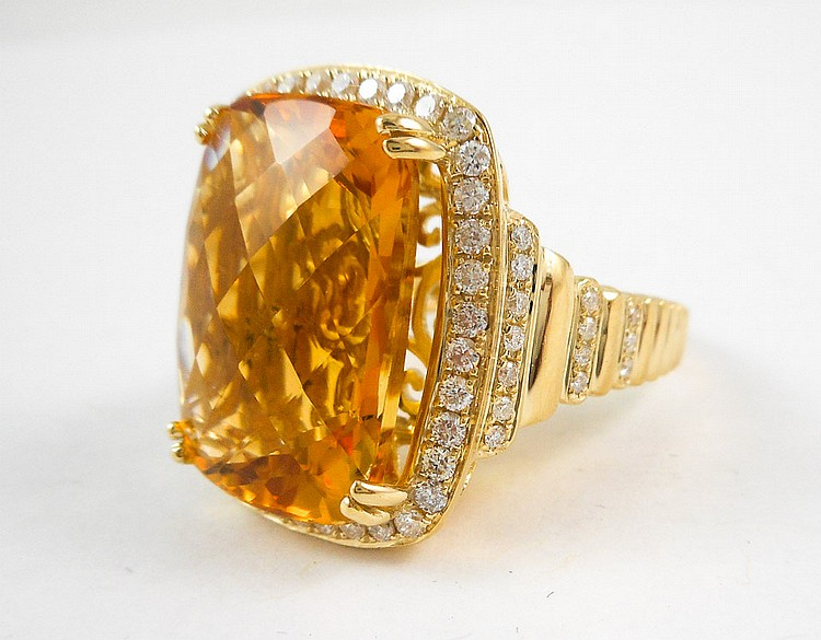 CITRINE, DIAMOND AND FOURTEEN KARAT GOLD RING, wit