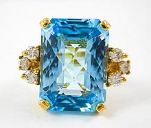 BLUE TOPAZ, DIAMOND AND YELLOW GOLD RING.  The 14k