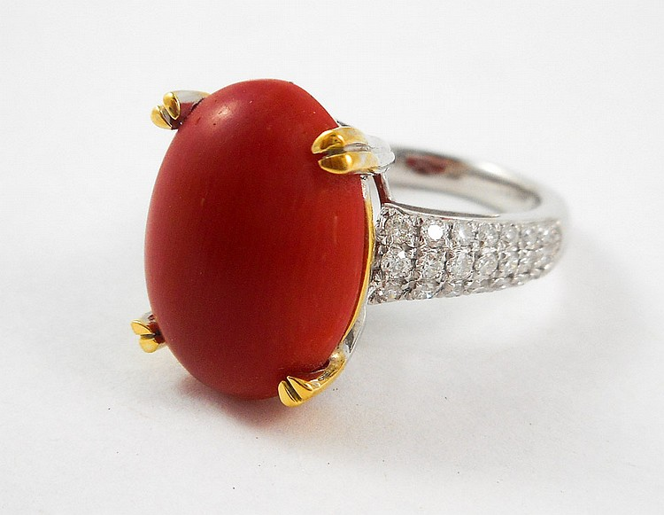CORAL, DIAMOND AND FOURTEEN KARAT GOLD RING.  The