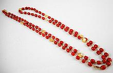 JAPANESE CORAL AND EIGHTEEN KARAT GOLD NECKLACE.