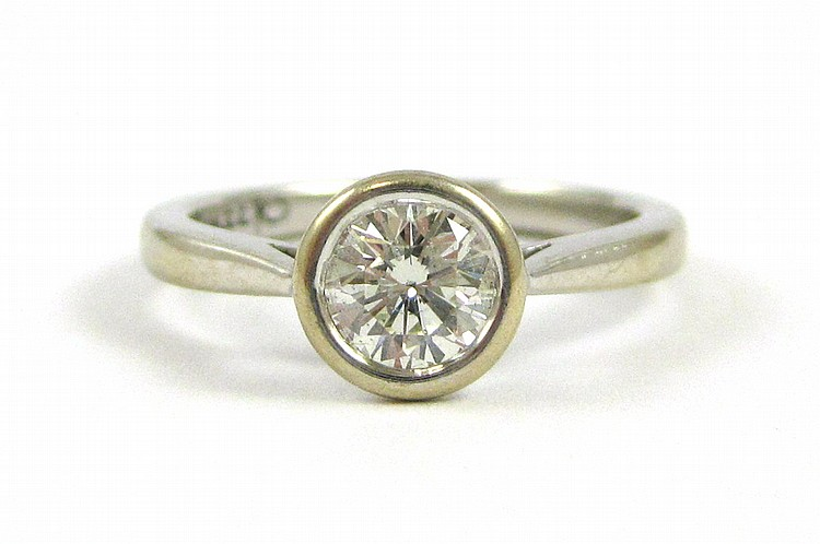 DIAMOND AND EIGHTEEN KARAT WHITE GOLD RING, featur