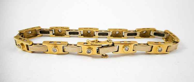 DIAMOND AND FOURTEEN KARAT GOLD BRACELET. The yel
